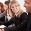 Business Woman In Meeting With Colleagues - Stock Photo