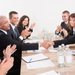 Business Team Sitting At Table And Applauding — Stock Photo #13241634