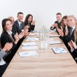 Business Team Sitting At Table And Applauding — Stock Photo #13241636