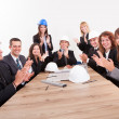 Engineers Sitting At Table And Applauding — Stock Photo #13241676