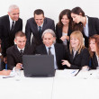 Stock Photo: BusinessmShowing On Laptop In Meeting