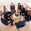 Royalty-Free Stock Photo: Group Of Business Sitting On Chairs