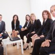 Stock Photo: Group Of Business Sitting On Chairs