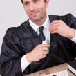 Male Judge Putting Some Money In His Pocket — Stock Photo