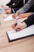 Businesspeople Taking Notes — Stock Photo