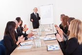 Business Team Sitting At Table And Applauding — Stock Photo