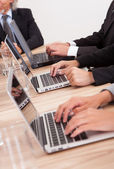 Businesspeople Using Laptop — Stock Photo