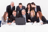 Businessman Showing On Laptop In Meeting — Stock Photo