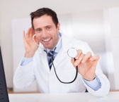 Portrait Of Male Doctor Holding A Stethoscope — Stock Photo