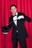 A Magician In A Black Suit — Stock Photo