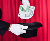 Magician Hand Holding 100 Euro Note — Stock Photo