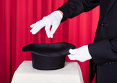 A Magician Performing Magic With Hat — Stock Photo
