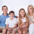 Happy Family On A Sofa Watching Tv — Stock Photo