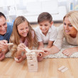 Happy Family Playing With The Wooden Blocks — Stockfoto