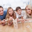 Stock Photo: Happy Family Playing With The Wooden Blocks