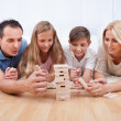 Happy Family Playing With The Wooden Blocks — Stock Photo