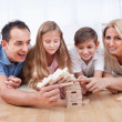 Happy Family Collapsing The Wooden Blocks - Stock Photo