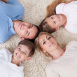 Close-up Of Happy Family Looking Up Together - Stock Photo