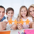 Family Holding Paper In Hand — Stock Photo #13470392