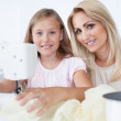 Beautiful Young Girl Sewing With Her Mother — Stock Photo #13470422