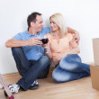 Couple Sitting Between Cardboard Boxes — Stock Photo