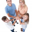 Stock Photo: Elevated View Of Family Putting Hands Together