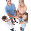 Elevated View Of Family Putting Hands Together - Stock Photo