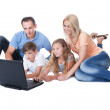 Happy Family With Two Children Using Laptop — Stock Photo