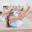 Family Doing Stretching Exercises — Stock Photo