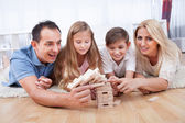 Happy Family Collapsing The Wooden Blocks — Stock Photo