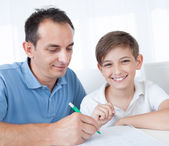 Portrait Of Father And Son Doing Homework — Stock Photo