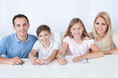 Parents Helping Their Children With Their Homework — Stock Photo