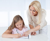 Mother Helping Her Daughter With Homework — Stock Photo