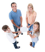 Elevated View Of Family Holding Blank Paper — Stock Photo