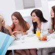 Women friends looking at shopping — Stock Photo #13652355