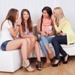 Four women gossiping — Stock Photo #13651885