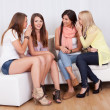 Four women gossiping — Stock Photo