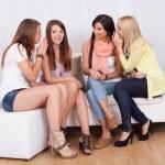 Four women gossiping — Stock Photo