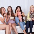 Four beautiful women watching TV - Foto de Stock  