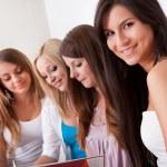 Four female students doing homework — Stock Photo