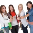 Smiling female students with a thumbs up - Stock Photo