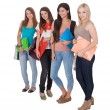Four female students in a row - Stock Photo