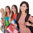 Stock Photo: Four female students in a row