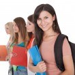 Four female students in a row — Stock Photo #13652257