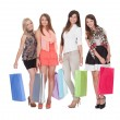 Four happy female shoppers — Stock Photo