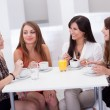 Stock Photo: Female friends chatting over coffee