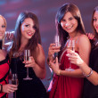 Stock Photo: Stylish women toasting with champagne