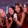 Four beautiful girls singing karaoke - 图库照片