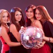Four smiling girls with a disco ball - 图库照片