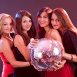 Four smiling girls with a disco ball - Foto Stock